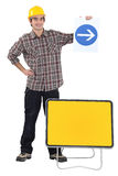 Man holding traffic sign Stock Photos