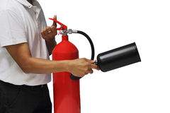 A man holding and training fire extinguisher. Isolated over white background Royalty Free Stock Photo