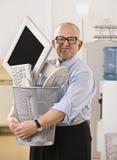 Man Holding Trash Bin Stock Image
