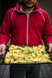 Man holding tray with potatoes Stock Photography