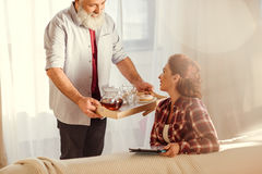 Man holding tray with tea Royalty Free Stock Image