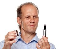 Man holding trimmer Royalty Free Stock Image