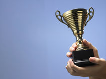 Man holding trophy. Man holding a champion golden trophy royalty free stock photos