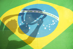 Man Holding Trophy Shadow Brazil Flag Royalty Free Stock Images