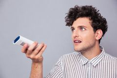 Man holding TV remote Royalty Free Stock Photography