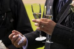 Man holding two champagne glasses Stock Photography