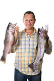Man holding two large fresh fish - trout in the hands of Royalty Free Stock Images