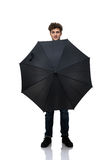 Man holding an umbrella in front of him Royalty Free Stock Photo