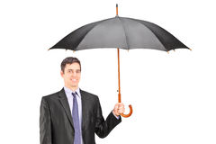 Man holding an umbrella Royalty Free Stock Images