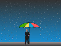 Man holding umbrella in rain Royalty Free Stock Image