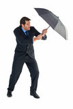 Man holding umbrella to protect himself from the rain Royalty Free Stock Images