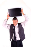 Man holding up a blank screen. A man holding a blank monitor over his head Stock Images