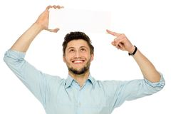 Man holding up blank sign above his head Royalty Free Stock Photos
