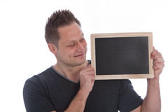Man holding up a blank slate Stock Photos