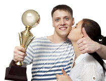 Man holding up a gold trophy cup as a winner in a competition is Royalty Free Stock Photos