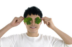 Man holding up a green leaf Stock Images