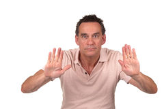 Man Holding Up Hands to Stop or Push Royalty Free Stock Photo