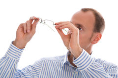 Man holding up his glasses and looking at them isolated on white Stock Photos