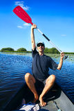 Man holding up his paddle Stock Photography