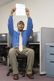 Man holding up his resume Royalty Free Stock Photography