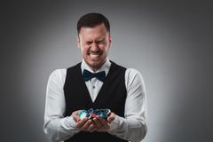 A man holding up poker chips. Poker Royalty Free Stock Image
