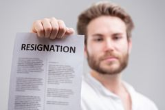 Man holding up a resignation letter stock photography