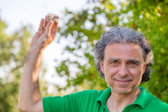 Man holding up a rock Royalty Free Stock Images