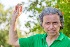 Man holding up a rock Royalty Free Stock Photo