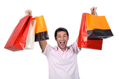 Man holding up shopping bags Stock Photo