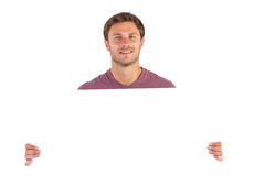 Man holding up a sign Stock Images