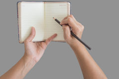 Man holding up a small blank opened diary Stock Photo