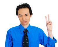 Man holding up victory sign Stock Photo