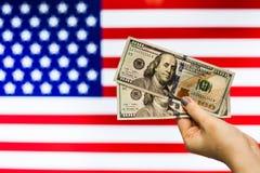 Man holding US Dollar bank note indicating market crash Stock Photo