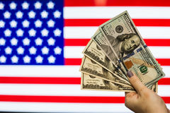 Man holding US Dollar bank note indicating market crash Royalty Free Stock Photography