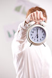 Man holding a vintage alarm clock Stock Photo