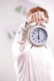 Man holding a vintage alarm clock Stock Photo