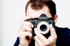 Man holding vintage camera, photographer Royalty Free Stock Photography