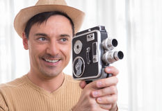 Man holding vintage video camera Royalty Free Stock Images