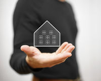 Man holding virtual house. Property and real estate concept Royalty Free Stock Images