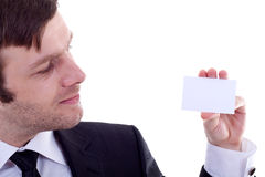Man holding a visiting card Royalty Free Stock Image