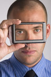 Man holding visual display device Royalty Free Stock Photo