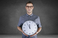 Man holding wall clock Stock Images
