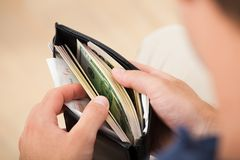 Man holding wallet with banknotes Stock Image