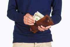 Man Holding a Wallet and Counting Dollars Stock Images