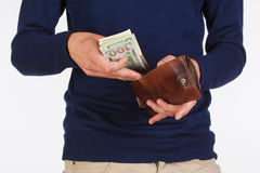 Man Holding a Wallet and Counting Dollars Stock Photos