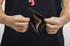 Man holding a wallet with money Royalty Free Stock Photography