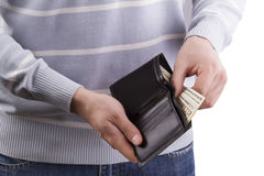 Man holding a wallet with money Stock Photography