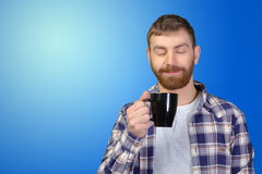 Man holding warm cup of tea/coffee Stock Images