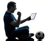 Man holding watching digital tablet  silhouette. One caucasian man holding digital tablet   in silhouette on white background Royalty Free Stock Images