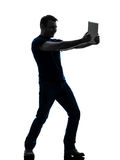 Man holding watching  digital tablet  silhouette. One  man holding watching digital tablet in silhouette on white background Stock Images